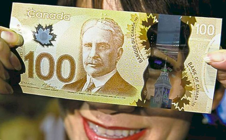 woman and 100 Canadian dollars